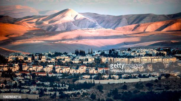 This picture taken on November 17 2018 from East Jerusalem shows a view of the Israeli settlement of Maale Adumim with the Judaean desert seen in the...