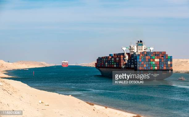 This picture taken on November 17, 2019 shows the Liberia-flagged container ship RDO Concord sailing through Egypt's Suez Canal in the canal's...