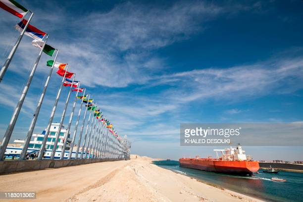 This picture taken on November 17, 2019 shows the Malaysia-flagged oil tanker Bunga Kasturi sailing through Egypt's Suez Canal in the canal's central...