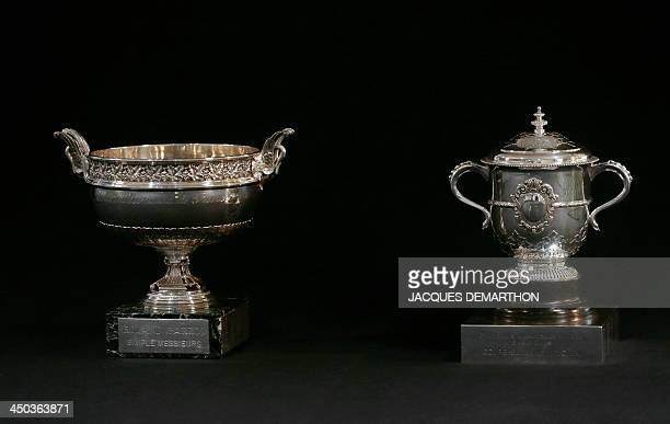 This picture taken on November 18, 2013 in Paris shows the Musketeers and the Suzanne Lenglen Cups, the French Grand Slam Tennis tournament Roland...