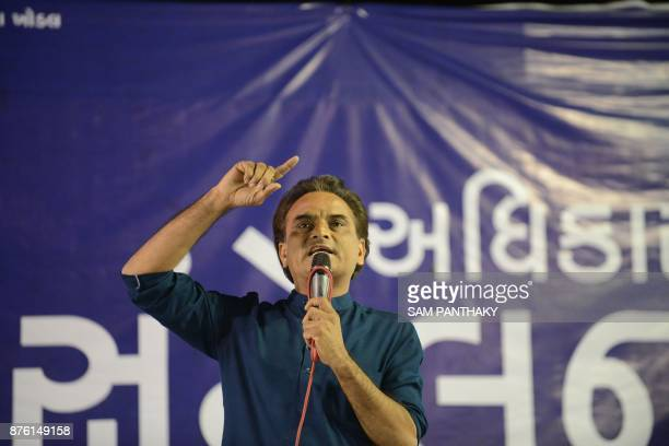 This picture taken on November 18 2017 shows Atul Patel one of the leaders of Patidar Anamat Andolan Samiti addressing a gathering during 'Adhikar...
