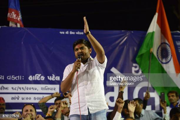 This picture taken on November 18 2017 shows Hardik Patel leader of Patidar Anamat Andolan Samiti addressing a gathering with his supporters during...