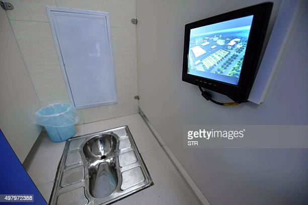 This picture taken on November 19 2015 shows the first public toilet equipped with WiFi a bank ATM machine and chargers for mobile phones and...