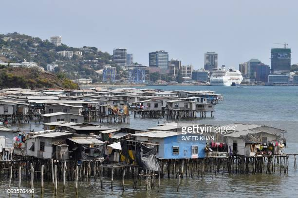This picture taken on November 19 2018 show makeshift huts seen across the ship accommodating delegates and journalists attending the AsiaPacific...