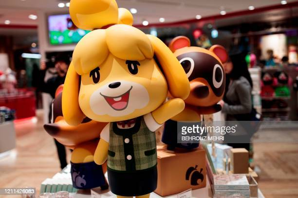 This picture taken on November 19, 2019 shows dolls of Nintendo game characters Isabelle , known as Shizue in Japan, and Tom Nook , known in Japan as...