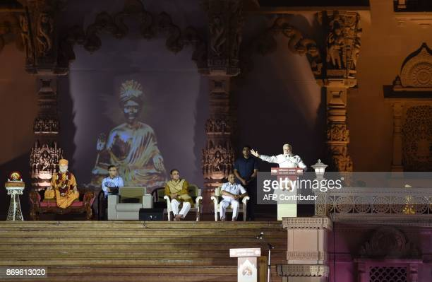 This picture taken on November 2 2017 shows Indian Prime Minister Narendra Modi speaking during the silver jubilee celebrations for the Akshardham...