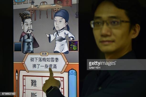 This picture taken on November 2 2017 shows Steve Tsai an APP designer of Zihun instroducing his APP during an interview in Taipei Concerns in Taiwan...