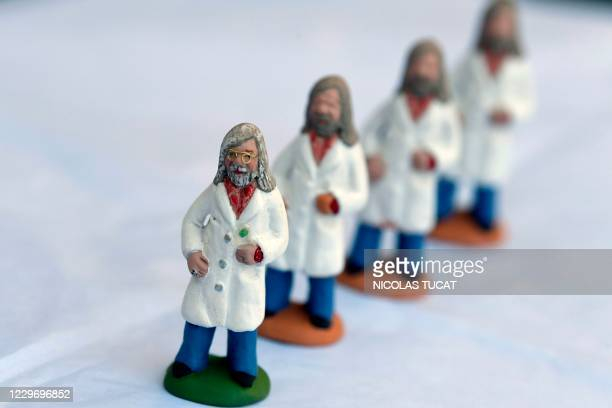 This picture taken on November 20 in Saint-Cyr-sur-Mer, southeastern France, shows santons, small hand-painted terracotta nativity scene figurines...