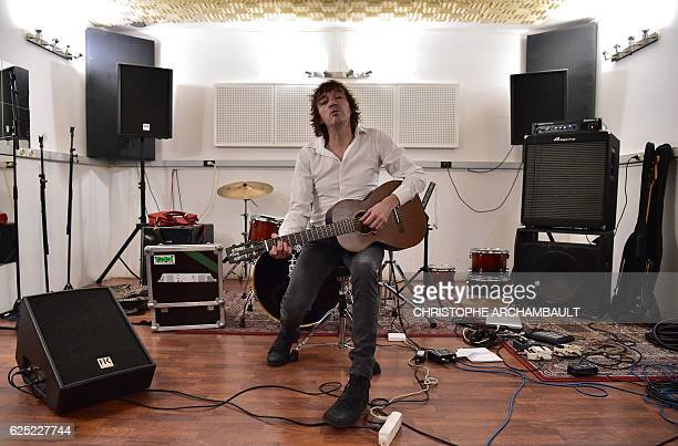 This picture taken on November 21 2016 shows French singer Cali whose real name is Bruno Caliciuri posing for photos at recording studios in Paris /...