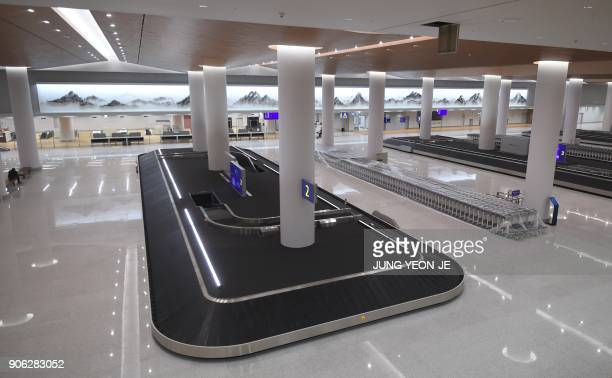 This picture taken on November 21 2017 shows a general view of the baggage claim at Terminal 2 of Incheon International Airport west of Seoul during...