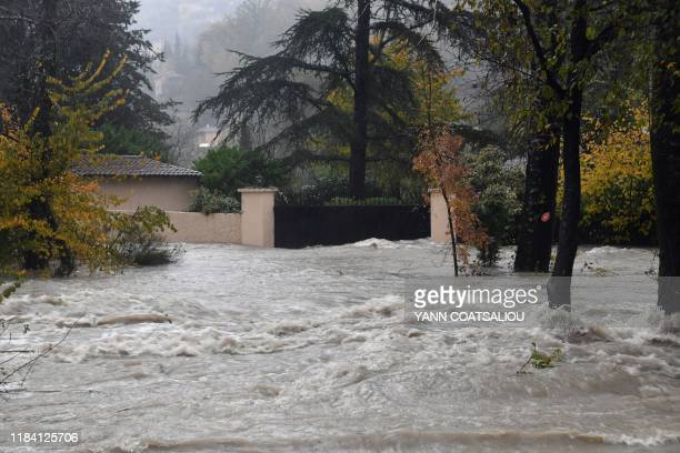 This picture taken on November 23 2019 shows a view of the high waters of the Loup river flooding its surroundings in Pont du Loup southeastern...