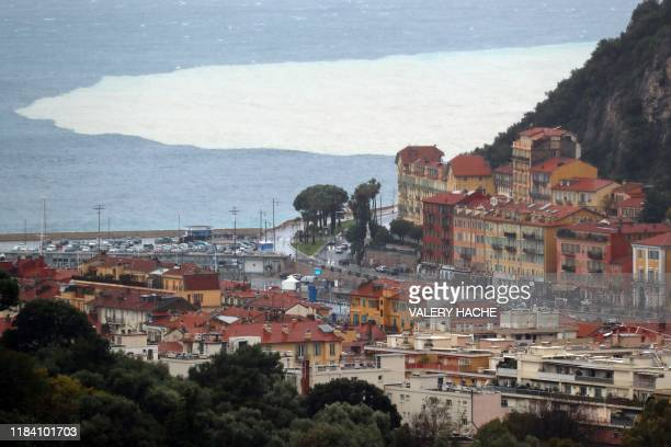 This picture taken on November 23, 2019 shows a view of the sludge from the Paillon River poured in the Mediterranean sea following heavy rains, in...
