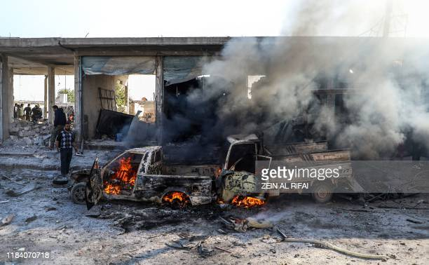 This picture taken on November 23, 2019 shows the aftermath of a car bomb explosion at the industrial zone in the northern Syrian town of Tal Abyad,...