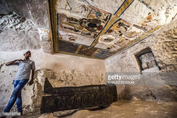 This picture taken on November 24 2018 shows a carved black wooden sarcophagus inlaid with gilded sheets dating to Egypt's Late period lying in a...