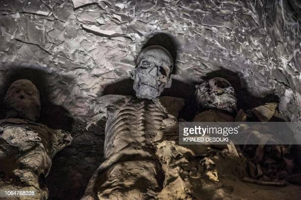This picture taken on November 24 2018 shows a group of mummies stacked together at the site of Tomb TT28 which was discovered by an Egyptian...