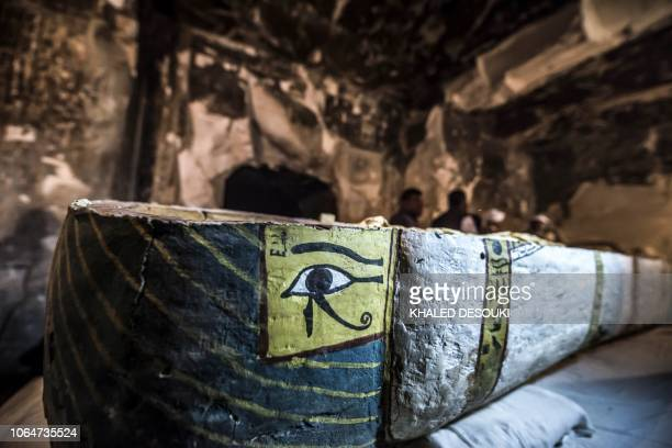 This picture taken on November 24 2018 shows a view of an opened intact Egyptian sarcophagus containing a wellpreserved mummy of a woman named Thuya...