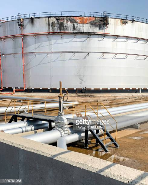 This picture taken on November 24, 2020 shows a view of a damaged silo at the Saudi Aramco oil facility in Saudi Arabia's Red Sea city of Jeddah. -...