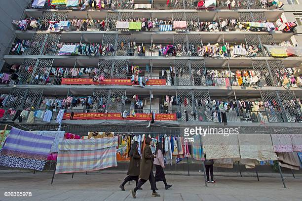 TOPSHOT This picture taken on November 26 2016 shows laundry and bedding hanging out to dry at the women's dormitory of the Hubei traditional Chinese...