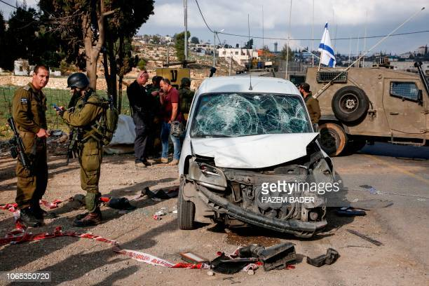 This picture taken on November 26 2018 shows a damaged car at the scene of an attack where a Palestinian man rammed a vehicle into three Israeli...