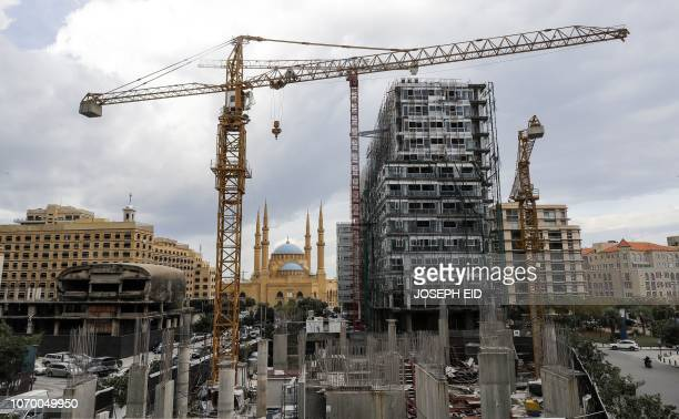 This picture taken on November 26 2018 shows a view of a halted construction site and another still under construction in the downtown district of...