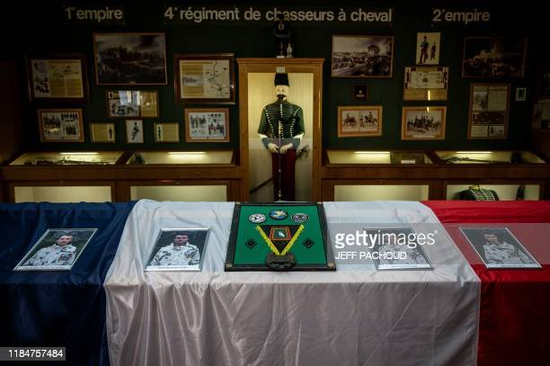 This picture taken on November 26 2019 shows the portraits of four soldiers of the Gaps 4th regiment de chasseurs who died in Mali on November 25...