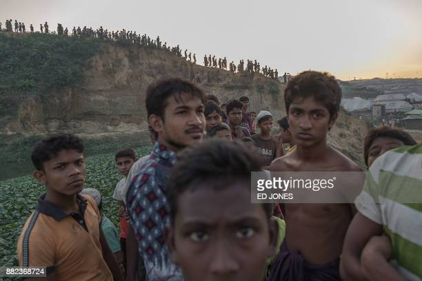 TOPSHOT This picture taken on November 26 shows Rohingya Muslim refugees looking on near Kutupalong refugee camp at Cox's Bazar The plight of the...