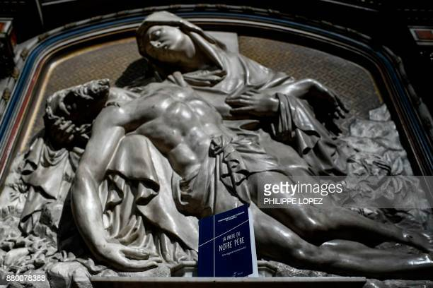 This picture taken on November 27 2017 at the NotreDamedesVictoires basilica in Paris shows the new version of the Lord's Prayer Catholic prayer book...