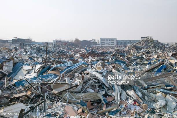 TOPSHOT This picture taken on November 27 2017 shows the wreckage of buildings which had been destroyed by the municipality on the outskirts of...