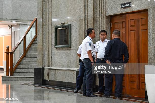 This picture taken on November 27 2018 shows Indonesian transportation officials standing in front of the entrance to a meeting between the National...