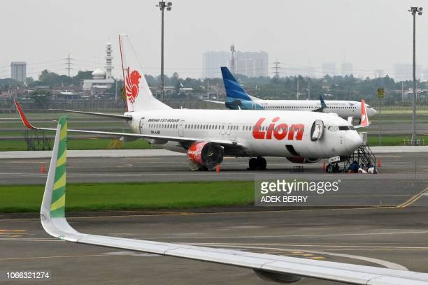 This picture taken on November 27 2018 shows Lion Air and Garuda Indonesia planes at the SukarnoHatta International Airport in Tangerang on the...