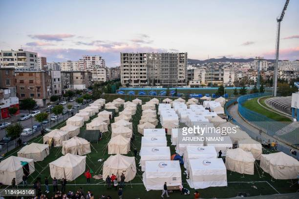 This picture taken on November 27, 2019 shows a general view of a makeshift camp at the soccer stadium in Durres, western Albania, after the...