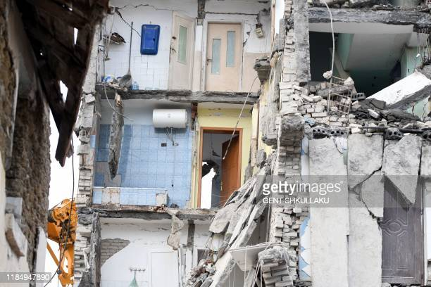 This picture taken on November 27, 2019 shows a view of a collapsed building in Thumane, northwest of the capital Tirana, after an earthquake hit...