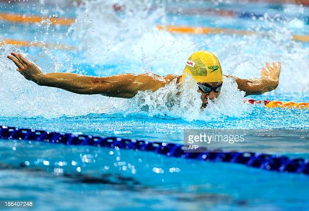 This picture taken on November 3 2012 shows Kenneth To of Australia on his way to win the men's 100m Butterfly at Beijing's shortcourse swimming...