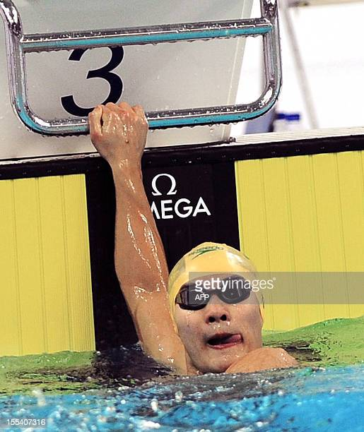 This picture taken on November 3 2012 shows Kenneth To of Australia after winning the men's 100m Butterfly at Beijing's shortcourse swimming World...