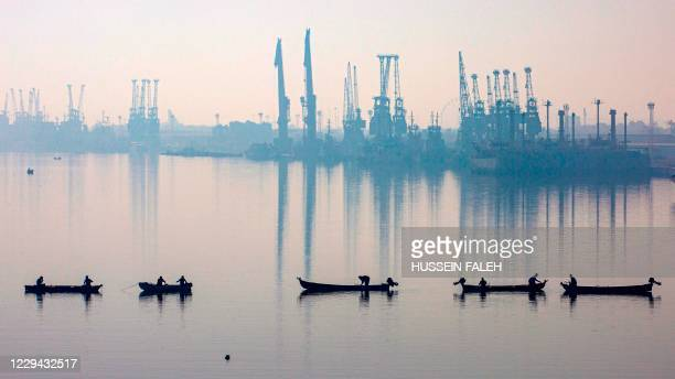 This picture taken on November 3, 2020 shows a general view of of fishermen in their boats by the main port of Maqil in Iraq's southern city of Basra...