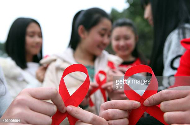 This picture taken on November 30 2015 shows volunteers taking part in an event to mark World Aids Day in Chongqing CHINA OUT AFP PHOTO / AFP / STR