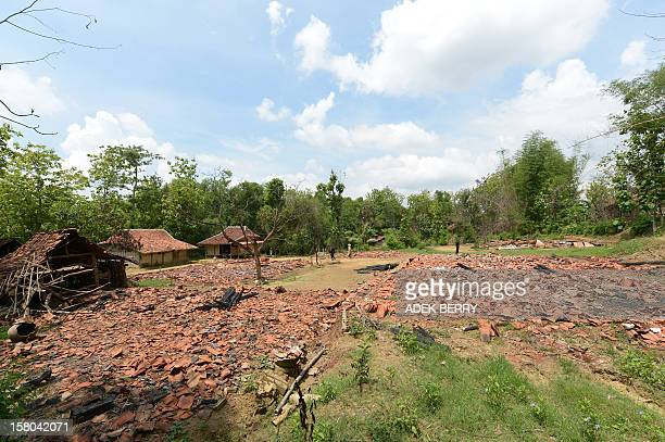 This picture taken on November 30 shows a village where houses belong to Muslim Shiites had been burnt down during a clash, at Bluuran village in...