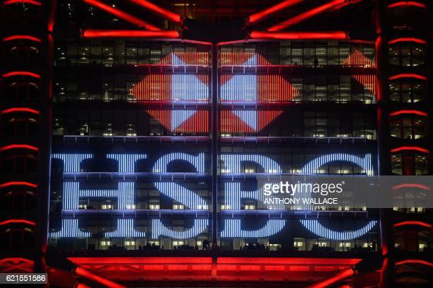 This picture taken on November 4 2016 shows the illuminated HSBC logo at night on the facade of the HSBC headquarters building in Hong Kong HSBC said...