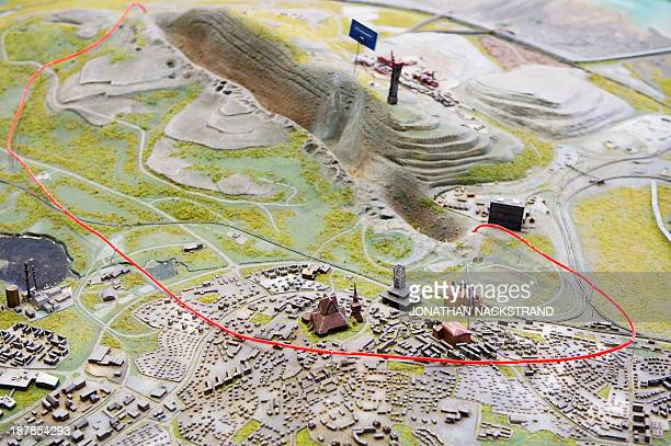 This picture taken on November 5 2013 shows a red wire on a model of Sweden's northernmost town of Kiruna that marks the area of the town which will...