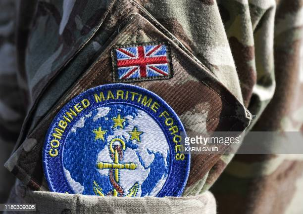 This picture taken on November 5 2019 during the the International Maritime Exercise in the Gulf waters off Bahrain shows a closeup of the badge of...