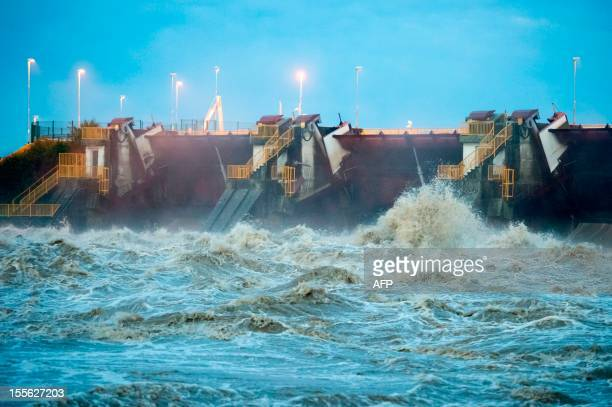 This picture taken on November 6, 2012 shows the Markovci dam, across the flooded Drava river, in Markovci, some 40 km south of Maribor as Slovenian...
