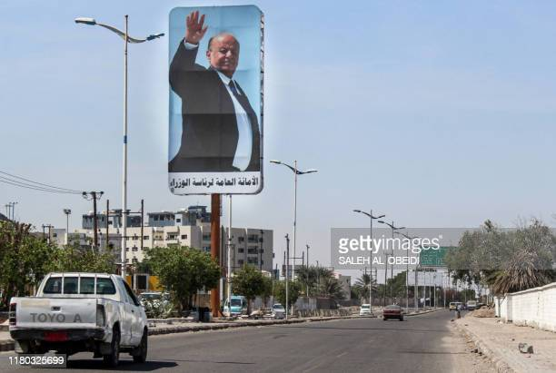 This picture taken on November 6, 2019 shows a billboard bearing a portrait of Yemen's Saudi-backed President Abedrabbo Mansour Hadi on a main road...
