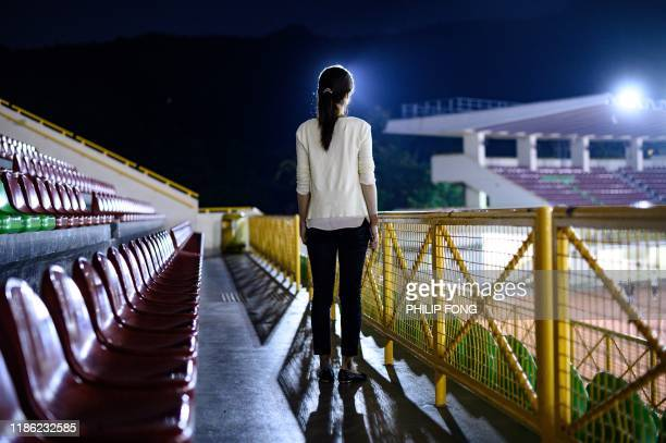 This picture taken on November 6 2019 shows a mainland Chinese woman using the pseudonym Christine Wang posing for a photo after an interview with...