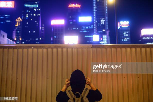 This picture taken on November 7 2019 shows a mainland Chinese man using the pseudonym Qixian Ye posing for a photo after an interview with AFP in...