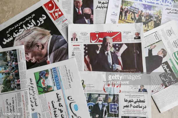 This picture taken on November 8, 2020 in Iran's capital Tehran shows a view of Iranian Farsi newspapers with headlines featuring the 2020 US general...