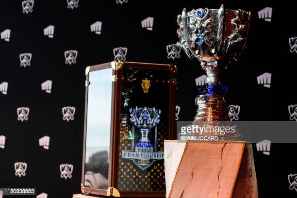 This picture taken on November 8 shows the cup of the League of Legends displayed at the Eiffel Tower in Paris during a press conference ahead of the...
