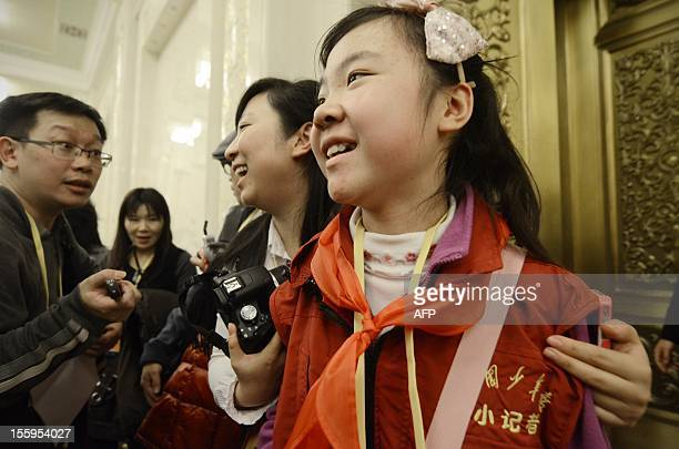 This picture taken on November 9,2012 shows Sun Luyuan, a Beijing sixth-grade student being interviewed at the Great Hall of the People during the...