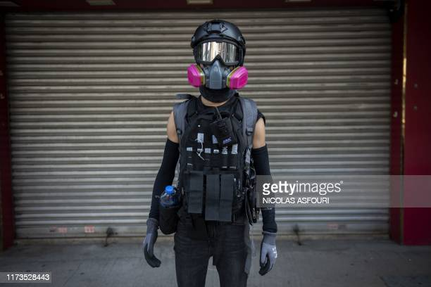 This picture taken on October 1 2019 shows a masked prodemocracy protester posing for a portrait in Hong Kong as the city observes the National Day...