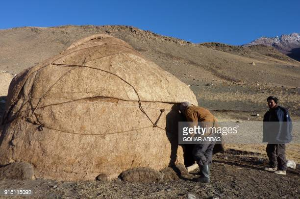 This picture taken on October 10 2017 shows a Kyrgyz boy entering his traditional yurt in the Wakhan Corridor in Afghanistan For centuries the...