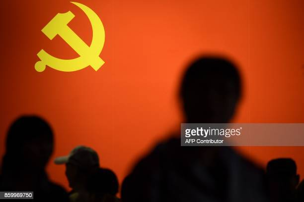 This picture taken on October 10, 2017 shows a party flag of the Chinese Communist Party displayed at an exhibition showcasing China's progress in...